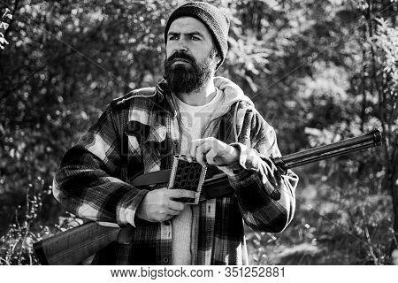 Hunting In Russia. Hunter With Shotgun Gun On Hunt. Close Up Portrait Of Hamdsome Hunter. Autunm Hun