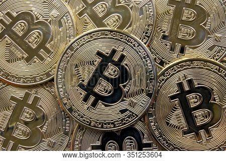 A Closeup Of A Stack Of Shiny Golden Bitcoins.