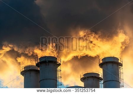 Industrial Chimneys Spewing Smoke And Soot In The Blue Sky Polluting The Air And Causing Global Warm