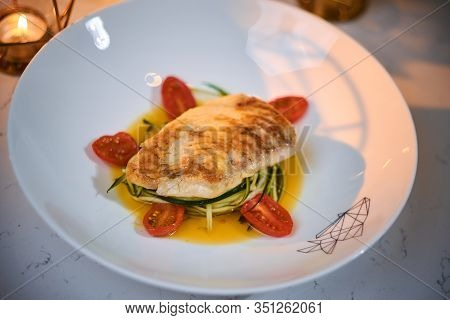 Delicious Fillet Of Grilled And Oven Baked Codfish Or Coalfish Served With Thin Sliced Vegetables An