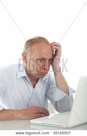 Frustrated Bemused Man With Laptop