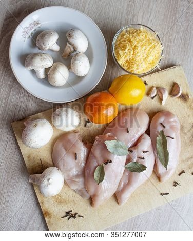 Wooden Table With Parmesan Cheese And Mushrooms And Filet. Variety Of Products. Nutrition Healthy Nu