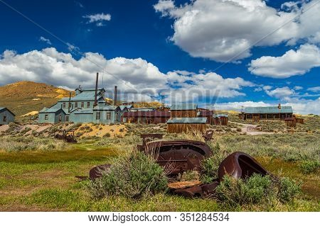 View Of The Bodie, Ghost Town. Bodie State Historic Park. Abandoned Wooden Houses And Standard Conso