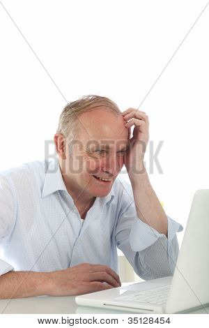 Excited Man Reading His Laptop Screen