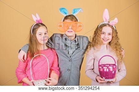 Spring In Her Basket. It Is Spring Time. Children In Rabbit Bunny Ears. Egg Hunt. Family And Sisterh
