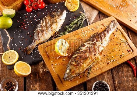 Grilled Sea Bass With Vegetables On A Cutting Board
