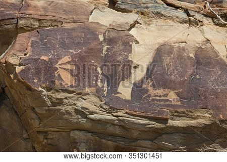 Ancient Petroglyphs Of A Rabbit And A Antelope Are Carved Into Sandstone Rocks Along With Some More