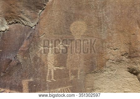 Strange Shapes And Figures That Have Been Carved Into The Ancient Sandstone Rocks At Legend Rock Sta
