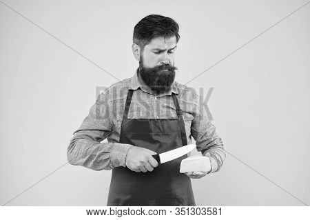 Expertise Cheese Taste. Ciet And Nutrition. Serious Bearded Man Cut Cheese With Knife. Cheesemaking