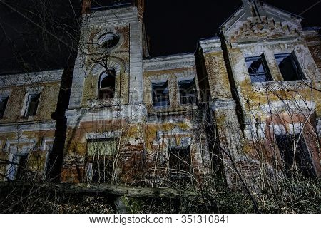Dark And Creepy Old Abandoned Haunted Mansion At Night. Former Karl Von Meck House