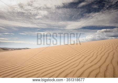 Sand Dune Texture And Cloudy Sky In Great Sand Dunes National Park