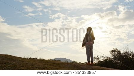 Woman look at the sky with sun flare light