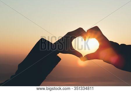Hands In Shape Of Love Heart .couple In Love