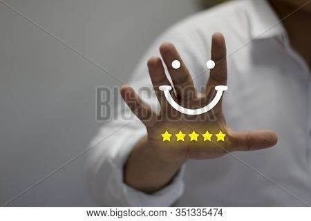 Businessman Pressing Smile Emoticon On Virtual Touch Screen. Customer Service Evaluation Concept.