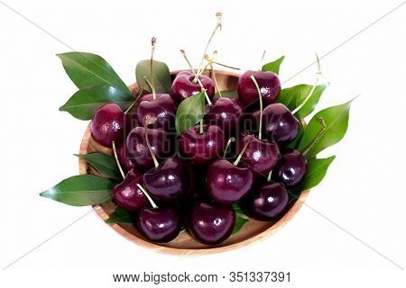 Texture Of Cherry In Wooden Plate Isolated On White Background. Sweet Fresh Cherry.