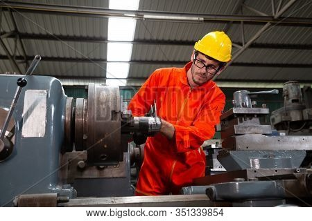 Heavy Industrial Worker Is Working On Metal Work Factory, Machine For Steel Structure Industry Conce