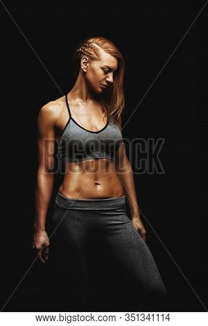 Young Fit Women In Sports Equipment, Sports Embossed Female Body, Black Background, Hard Light. Copy