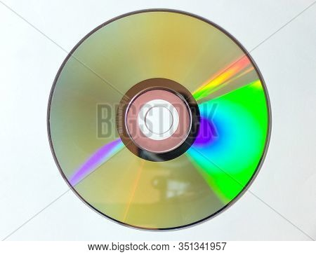 Dvd Cd Is Isolated On A White Background. Iridescent Disk In Close-up.