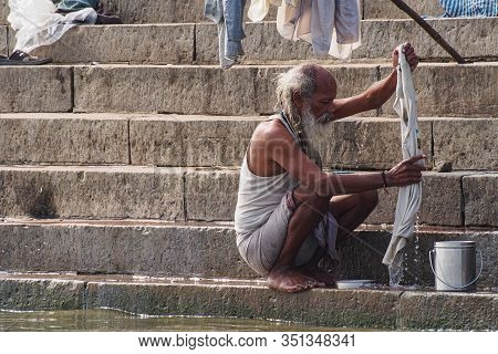 Varanasi, India - Dec 26, 2019: Hindu Taking Ritual Bath In The River Ganga In The Holy City Of Vara