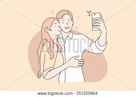 Couple In Love Take Selfie Concept. Boyfriend And Girlfriend Man And Woman Hug And Makes Photo Or Ta
