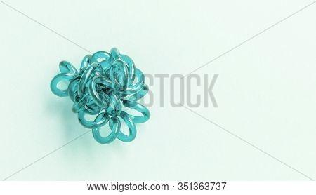 Aqua Menthe Spiral Elastic Hair Ties Twisted. Elastic Hair Tie On Aqua Menthe Background Close-up, C