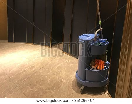 Blue Cleaning Tools Service Cart Waiting For Maid Or Cleaner In Luxurious Modern Restroom Of Hotel O