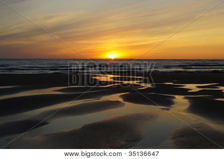 Sunset at the north sea beach