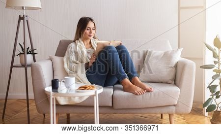Cozy Evening. Millennial Woman Reading Book At Home Interior, Panorama, Free Space
