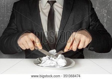 A Man Without A Face In A Black Suit And Tie Sits At A Table And Eats From A Plate A Crumpled Sheet