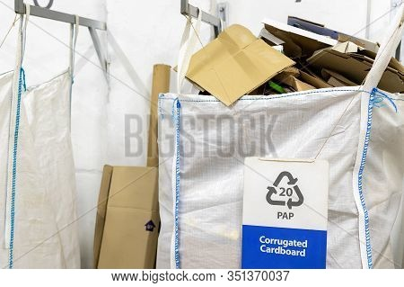 Recyclable Waste Collection, Sorting And Storage Point Center. White Big Bigbag Hanget On Metal Fram