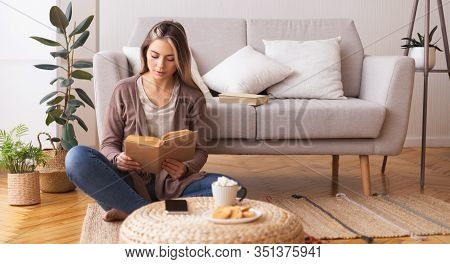 Self Education Concept. Young Woman Reading Book, Sitting On Floor At Home, Panorama, Free Space