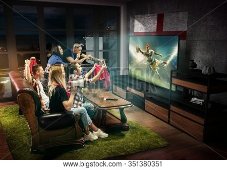 Group Of Friends Watching Tv, Match, Championship, Sport Games. Emotional Men And Women Cheering For