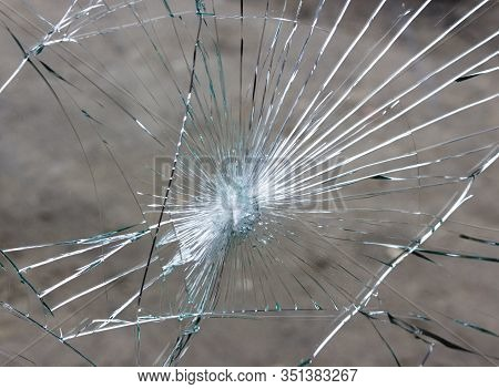 Broken Car Windshield, Cracks In Glass Due To Accident.