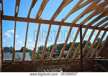 Roof Trusses Not Covered With Ceramic Tile On Detached House Under Construction,visible Roof Element