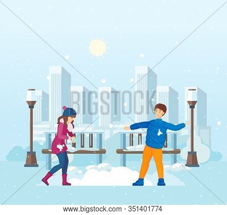 Couple Together Play Snowballs On Background Of City Park