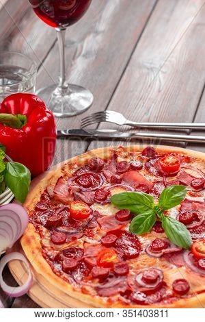Homemade Cheese Pizza With Salami. Creative Photo