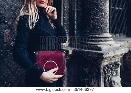 Female Fashion. Spring Accessories. Stylish Woman Wearing Dress And Holding Red Purse Outdoors. Clot