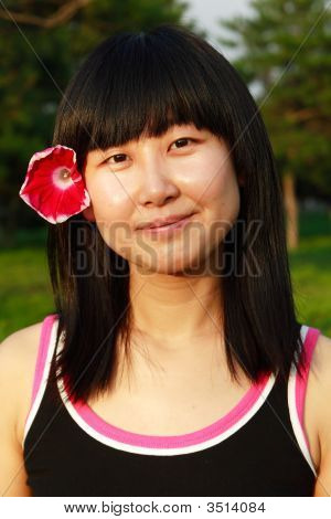 Chinese Little Girl And Flower