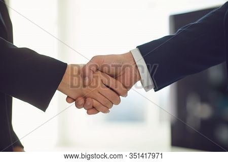 Handshake Of Businesspeople. Businesspeople Hands Makes A Handshake In The Office.