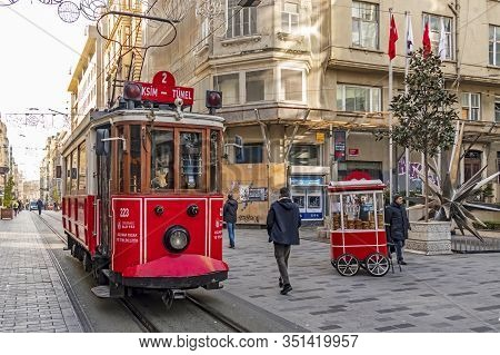 Istiklal Street,istanbul,turkey-february 18,touristy Red Nostalgic Tram On Istiklal Street Between M