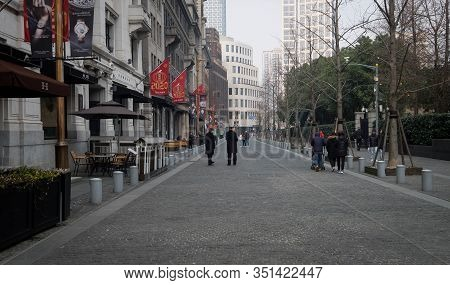 Shanghai, China - January 10 2020: Shanghai Empty Street, Many People Go To Walking On The Road. Sha