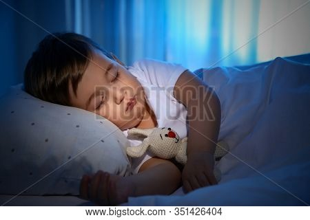 Cute Little Baby Sleeping With Toy At Home. Bedtime