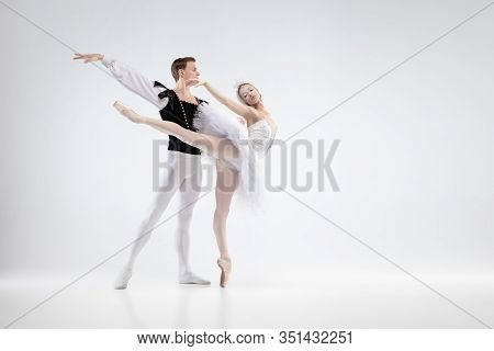 Holding. Graceful Classic Ballet Dancers Dancing Isolated On White Studio Background. Couple In Tend