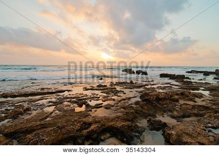 Sunset on a rocky beach, Israel