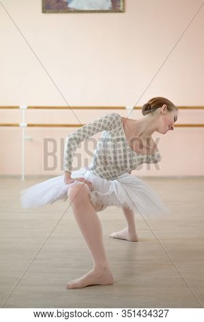 A Very Flexible Ballerina In A Tutu Stands In A Plie In A Class With Ballet Machines. Hypermobility