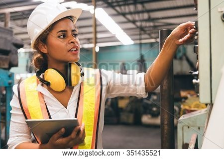 Industrial Factory Maintenance Engineers Woman Dark Skinned Inspect Relay Protection System Of Machi