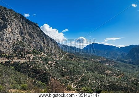 Greek Landscape, Picturesque Mountains And Blue Sky In Delphi, Greece. Coniferous Forest On Mountain