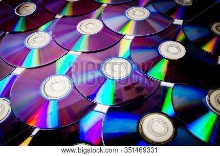 Background Cd And Dvd Discs Laid Out On A Flat Surface. Background For Saving Information. Abstracti
