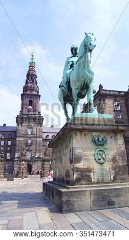 Copenhagen, Denmark - Jul 06th, 2015: Christiansborg Palace And King Christian Ix Statue. Famous Lan