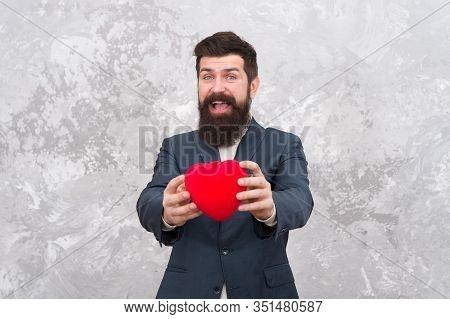 Romantic Boyfriend. Feast Of Saint Valentine. Generous Man. Handsome Confident Man Hold Red Heart. B
